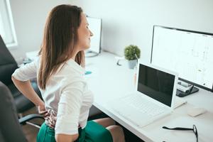 spine-care-woman-at-desk.jpg